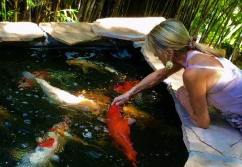 Andrea Prince feeding the koi
